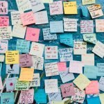 Post its with love notes on blue wall